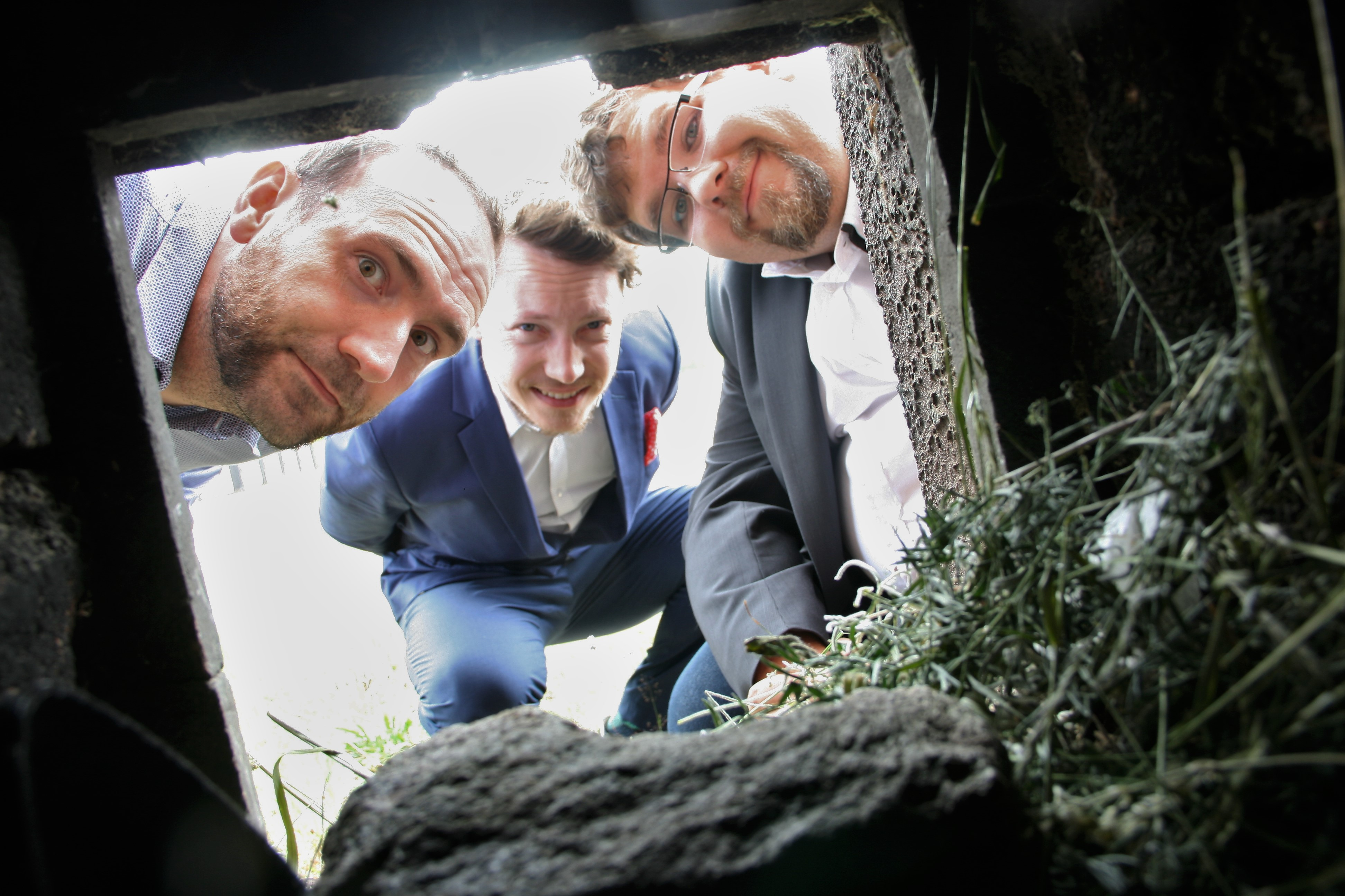 Team looking into an old chimney
